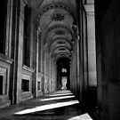 Arches in the shadows - Paris France by Norman Repacholi