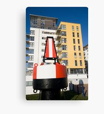 Buoy and Flats at Eastbourne Marina Canvas Print