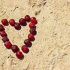 Fruit heart in the sand by Michelle Neeling