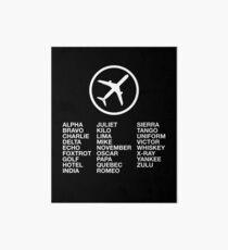 Lámina rígida El alfabeto fonético con una imagen de un avión.