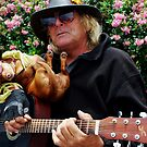 Dachshund and Guitar man in Sausilito by Marjorie Wallace