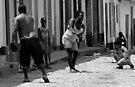 Baseball in the street, Trinidad, Cuba by David Carton