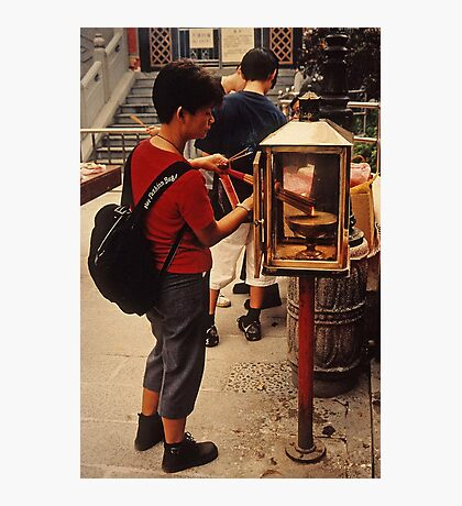 Lighting incense Photographic Print