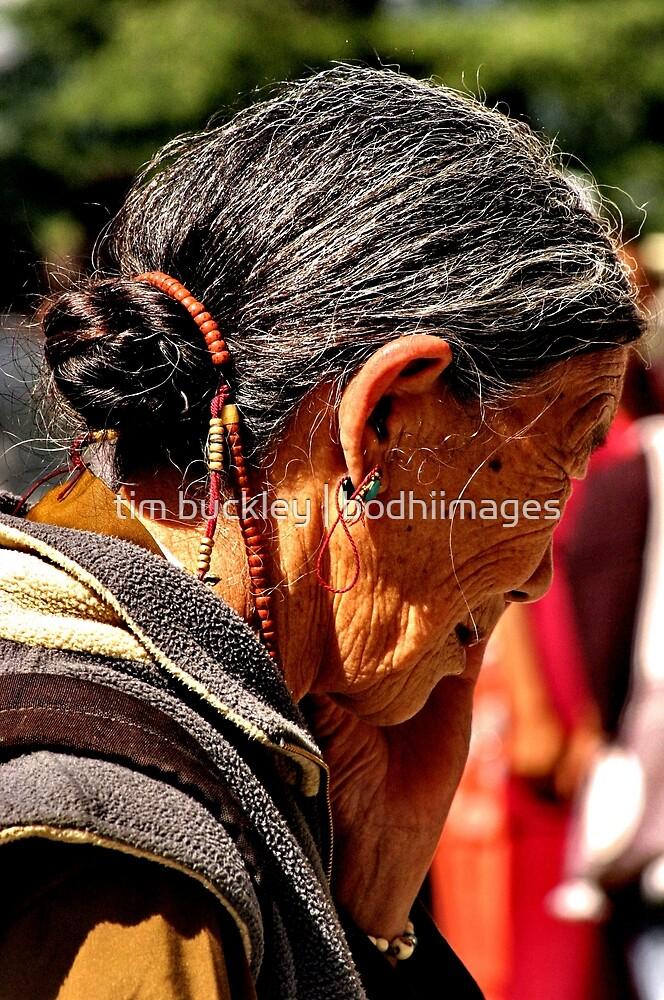 tibetan woman. northern india by tim buckley   bodhiimages