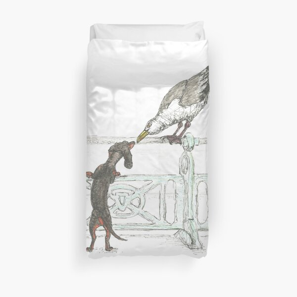 Dachshund and Seagull on Brighton Beach UK. Sausage dog by the sea. Duvet Cover