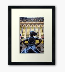 Fearless Girl statue facing the NYSE building Framed Print