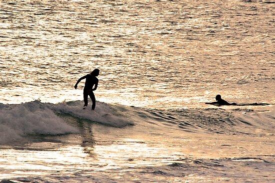 Surfer at Sunset by lightphotos