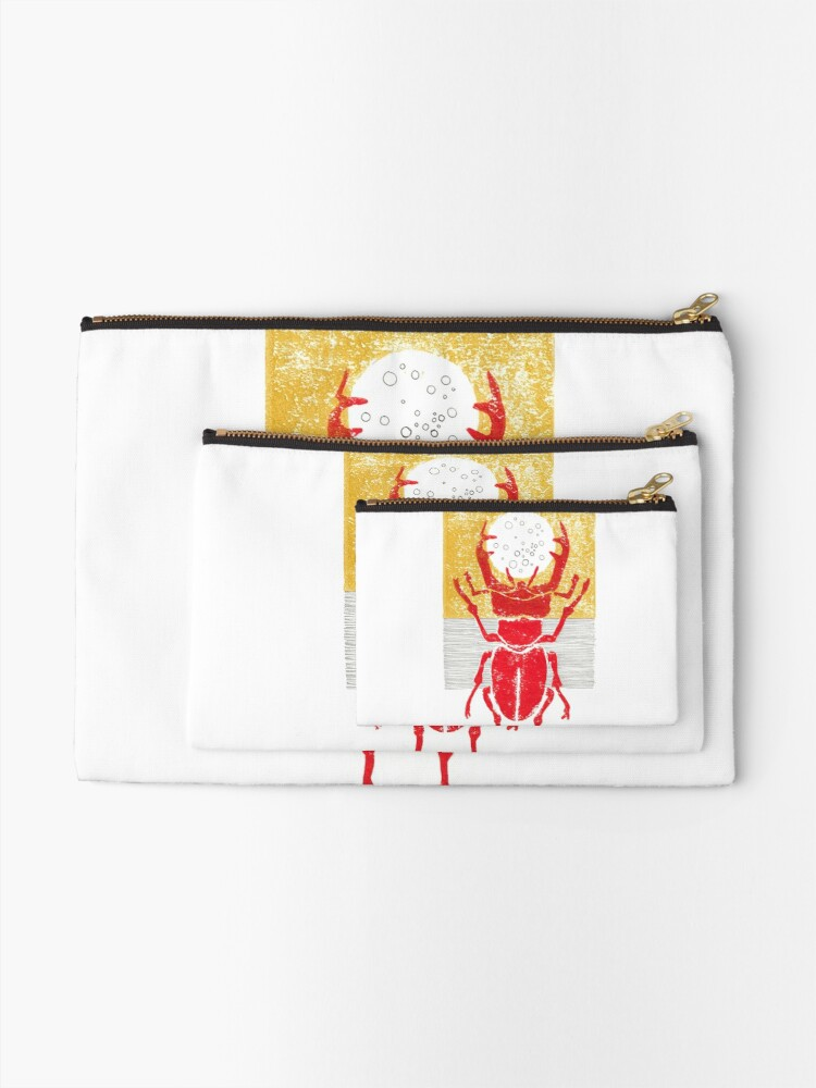 Alternate view of Red stag facing a golden sky Zipper Pouch