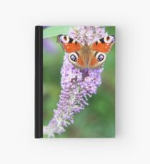 Peacock on a Buddleia Hardcover Journal