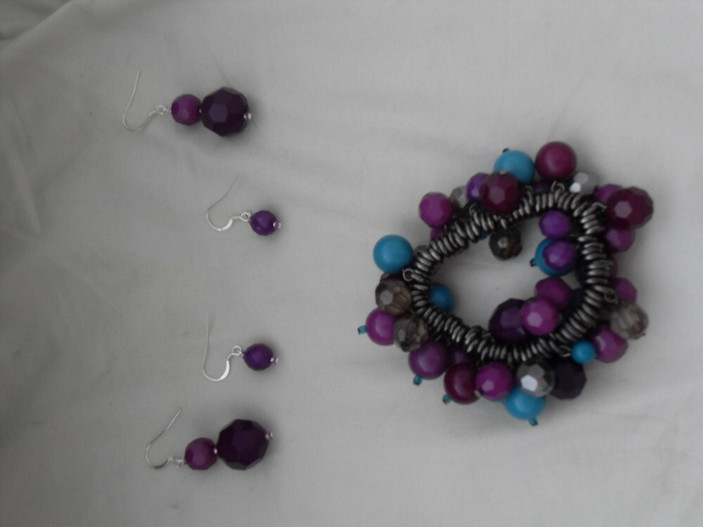 Claire's purple bobbly bracelet & earrings by sylversorceress