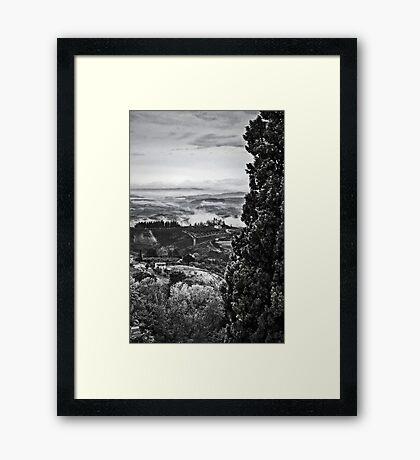 Hills wrapped in mist II Framed Print