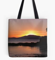 The sun setting on Wild Cat Cove Tote Bag