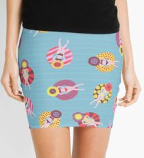 Floating devices in a pool seamless pattern. Women with sunhats on floaties chilling in the pool. Fun summer design. Summer vacation Mini Skirt