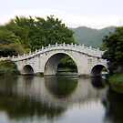 stone bridge in China by Dan Chang