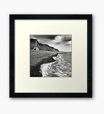 The pebble beach at Sheringham, Norfolk, UK Framed Print