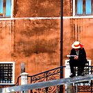 Gondola man at rest, venice, italy by georgelim