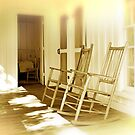 A Pair of Rocking Chairs on an Old Wooden Verandah by Mal Bray