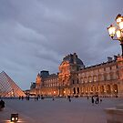 The Louvre and Pyramid in Paris, France by Jeff Hathaway