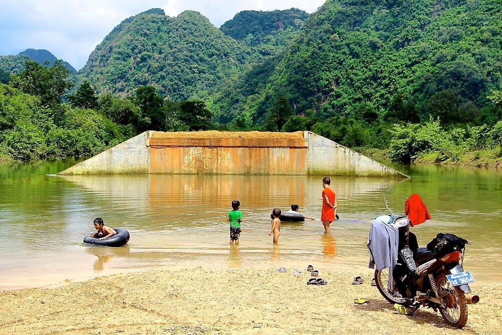Family Sunday at the River - Thakhek, Laos. by Tiffany Lenoir