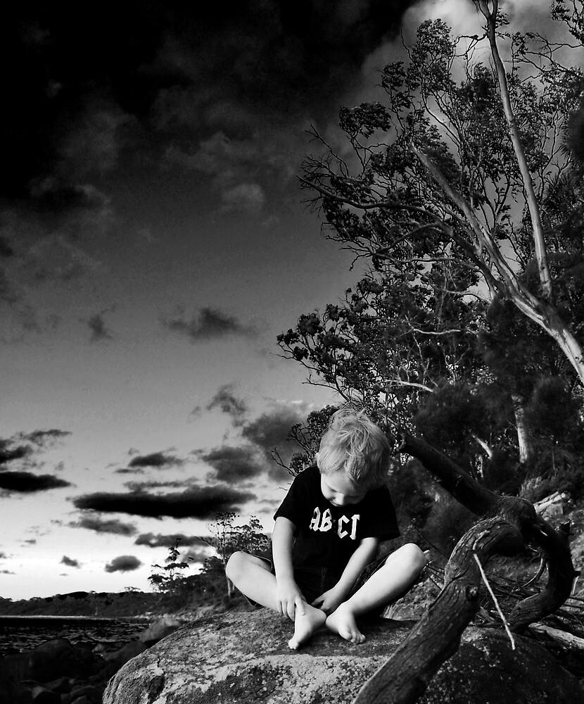 boy on rock by twistwashere