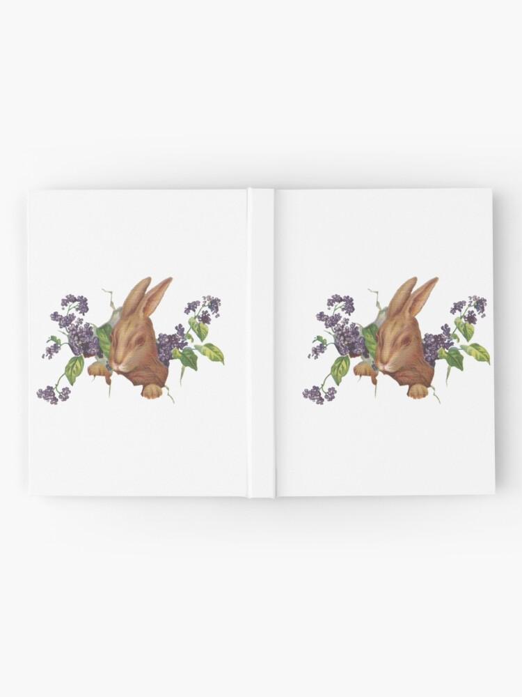 Alternative Ansicht von Ostern-Kaninchen, das vom Hintergrund mit Fliedern platzt Notizbuch