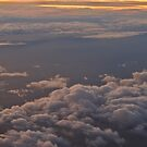 Cloudscape at sunset from an Airplane by AngeloDeVal