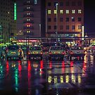 Taxi stand in the rain by Guillaume Marcotte