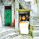Green door with chair by Giuseppe Cocco