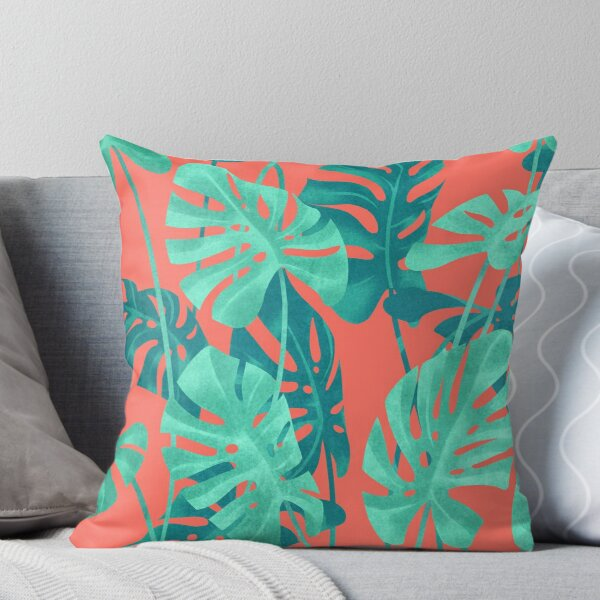 Monstera leaves on living coral. Throw Pillow
