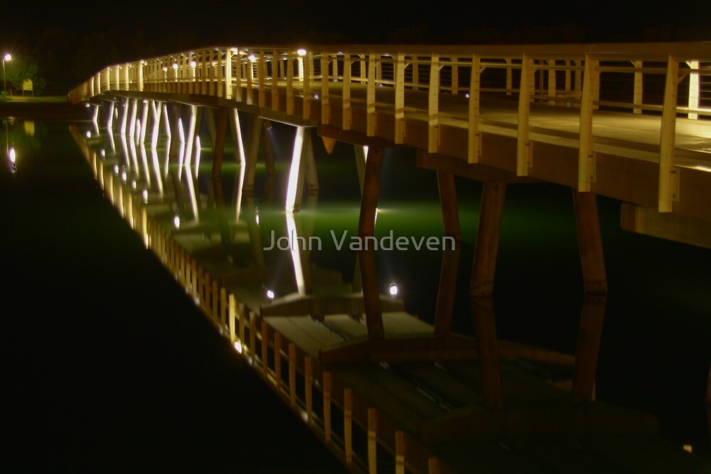 Lakes Entrance Bridge leading to the sea. by John Vandeven