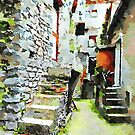 Buildings with stone stairs in the alley by Giuseppe Cocco