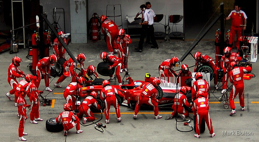 Pit Stop - Ferrari Pit Stop during Shanghai F1 race 2010 by Mark Bolton