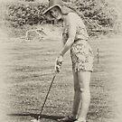 Grace playing golf by Karen  Betts