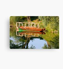 Rowboat on the river Canvas Print