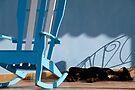 Sleeping dog & rocking chair, Cuba by David Carton