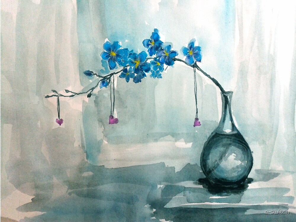 flowers in a clear vase by e-switch