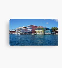Colorful Caribbean buildings over the water Canvas Print