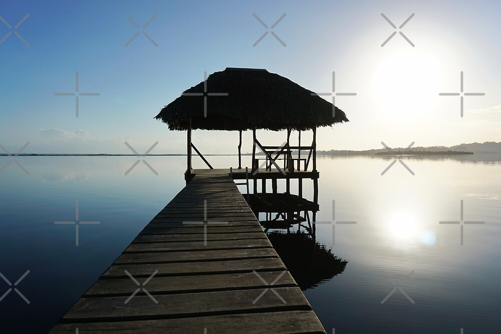 Dock with tropical hut over water on sunrise light by Dam - www.seaphotoart.com