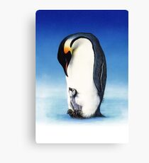 Emperor penguin with chick Canvas Print