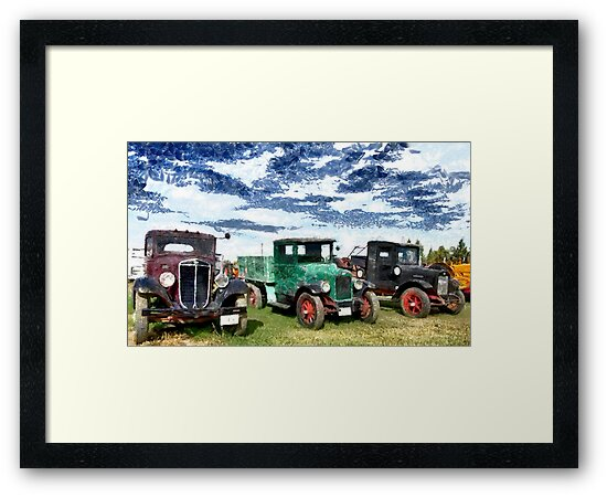 Antique trucks and cars along the road in Montana, USA by Dennis Melling