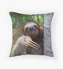 Portrait of Brown-Throated sloth on a tree Throw Pillow