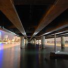 Under the Gold Coast Bridge at night by Graham E Mewburn