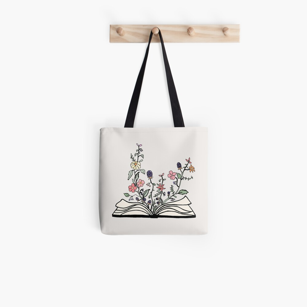 flowers growing from book  Tote Bag