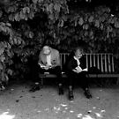 Old couple reading in Paris by Matteo Pezzi
