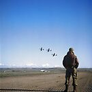 An unidentified Tuskegee airman standing on an airfield, looking at airplanes, Ramitelli, Italy by Marina Amaral