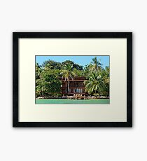 Tropical waterfront beach house Framed Print