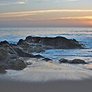 Waves, rocks and sunset in Salgados by AngeloDeVal
