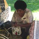 weaving baskets and hats etc in Fiji by Camelot