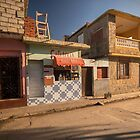 Beautiful and colourful little cafeteria in Trinidad, Cuba. by jonathankemp