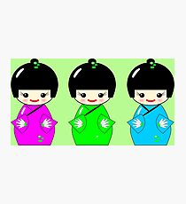 Cute Kokeshi dolls on green Photographic Print